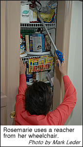 Rosemarie uses a reacher to access items high in a pantry